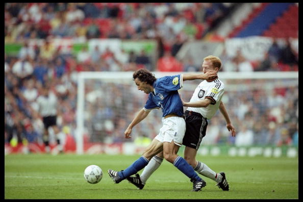 Roberto Donadoni of Italy (left) is challenged by Matthias Sammer of Germany